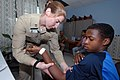 US Navy 070917-N-8704K-072 Lt. Gwen Smith, attached to Military Sealift Command hospital ship USNS Comfort (T-AH 20), performs physical therapy for Marcus Pryce at the Arima Health Facility.jpg