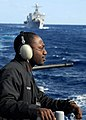 US Navy 080214-N-5067K-393 Seaman Kevin Taylor, the aft lookout for the amphibious transport dock USS Juneau (LPD 10) monitors the fleet replenishment oiler USNS Pecos (T-AO-197), not pictured, during an underway replenishment.jpg