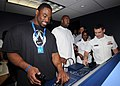 US Navy 090204-N-9758L-030 ) National Football League Pro Bowl players New York Giants Justin Tuck, left, and Tennessee Titans Albert Haynesworth man the lee helm and helmsman positions.jpg