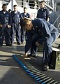 US Navy 090226-N-1251W-002 Gunners Mate 1st Class Leland Pasion explains how to inspect rounds for safety before a live-fire exercise aboard the amphibious dock landing ship USS Harpers Ferry (LSD 49).jpg