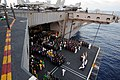 US Navy 090605-N-3659B-018 Sailors assigned to the aircraft carrier USS Ronald Reagan (CVN 76) and Carrier Air Wing (CVW) 14, assemble an aircraft elevator.jpg
