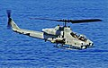 US Navy 090609-N-5345W-008 An AH-1W Super Cobra from the Thunder Chickens of Marine Medium Tiltrotor Squadron (VMM) 263 performs a low-altitude surveillance pass during a Visit, Board, Search and Seizure (VBSS) drill.jpg