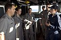 US Navy 090720-N-9123L-027 Ensign Colleen Praxmarer, the strike officer aboard the guided-missile destroyer USS McCampbell (DDG 85) answers questions on the bridge from sailors assigned to the Royal Australian Navy guided-missi.jpg