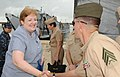 US Navy 091124-N-7353K-024 Sharon Featherstone, U.S. Charge' d' Affaires to Belize, shakes hands with Sgt. Daniel Newman during a ceremony marking the turnover of approximately 39,000 pounds of medical and school supplies.jpg