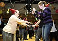 US Navy 091202-N-7280V-287 Personnel Specialist 3rd Class Alycia Hagen dances at the annual Christmas Disco Party for the disabled.jpg