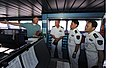 US Navy 101201-N-7589W-125 High Speed Vessel Swift (HSV 2) Ship's Master Rhett Mann, left, discusses navigational procedures on the bridge of the s.jpg