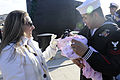 US Navy 101218-N-8467N-004 Electronics Technician 2nd Class Sergio Torres holds his 2-month-old daughter for the first time.jpg