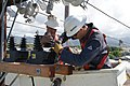 US Navy 110315-N-0278E-001 High-voltage electricians from Naval Facilities Engineering Command (NAVFAC) Hawaii reconfigure electrical circuitry.jpg