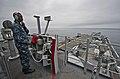 US Navy 110821-N-DX615-233 Seaman Deandre Johnson stands the forward lookout watch during flight operations aboard the amphibious assault ship USS.jpg