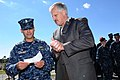 US Navy 111020-N-DD445-001 Cmdr. Peter Mirisola, the commanding officer of the guided-missile frigate USS Underwood (FFG 36), receives a $1,000 che.jpg