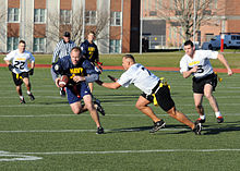 Photograph of men playing flag football