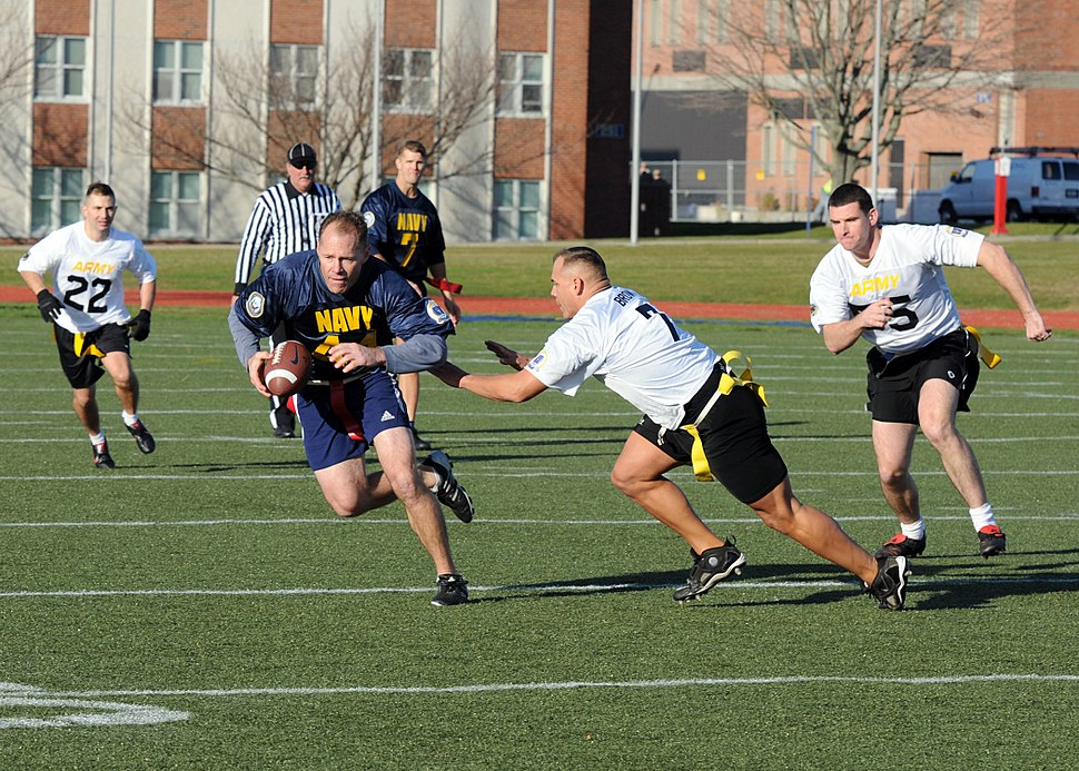 US Navy 111202-N-FC065-001 Cmdr. Bill Mallory tries for more yards after a reception during a flag football game celebrating the annual Army-Navy f