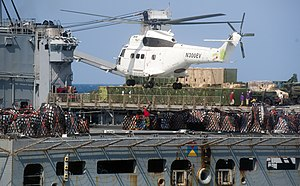 US Navy 111210-N-PB383-914 A helicopter from the Military Sealift Command dry cargo and ammunition ship USNS Alan Shepard (T-AKE 3) prepares to del.jpg