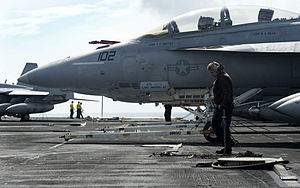 US Navy 120112-N-JN664-113 Aviation Structural Mechanic Airman Apprentice Jordan Ortiz secures an F-A-18F Super Hornet to the flight deck of the Ni.jpg