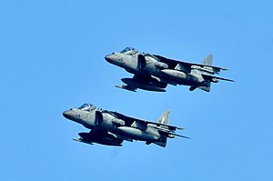US Navy 120202-N-UM734-431 A pair of AV-8B Harriers from Marine Fighter Squadron (VMA) 542 fly in formation during their approach to the amphibious.jpg
