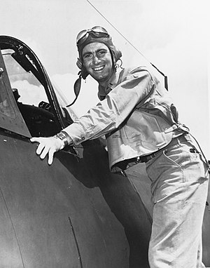 Ira C. Kepford - Kepford poses by the cockpit of an F4U after his second combat tour