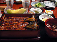 Photo of thin-sliced fish in restaurant setting