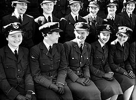 Two rows of seated women in dark military uniforms