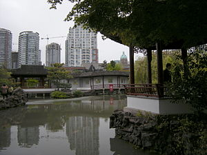 Urban parks in Canada - Highly developed parkland.  The Dr. Sun Yat-Sen Classical Chinese Garden with downtown Vancouver in the background.