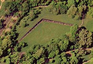 "Vietnam Veterans Memorial - An aerial photograph of ""The Wall"" taken on April 26, 2002 by the United States Geological Survey. The dots visible along the length of the angled wall are visitors. For a satellite view of the Wall in relation to other monuments, see Constitution Gardens."