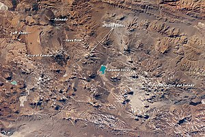 Ojos del Salado - Volcanic Landscapes of the Central Andes. Shown are Nevado Ojos del Salado, Cerro El Cóndor, and Peinado, along the Argentina-Chile border. Astronaut photo from ISS, 2010
