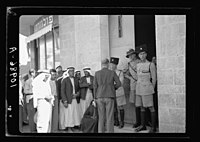 Volunteer queue outside government offices, waiting to register, mixed group, mostly Arabs LOC matpc.19895.jpg