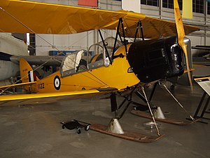 "British Commonwealth Air Training Plan - de Havilland Canada DH.82C in British Commonwealth Air Training Plan ""trainer yellow"" at the Western Canada Aviation Museum (note the skis, and the enclosed cockpit common to Canadian-built Tiger Moths)"