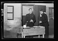 Warrant Officers' Club (Garrison Club at German colony, Jer. (i.e., Jerusalem) Playing a game of 'Tombolo' calling winning numbers LOC matpc.20449.jpg