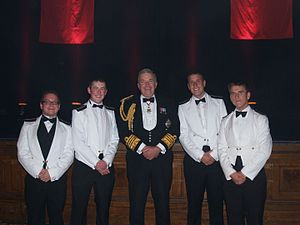 Merchant Navy (United Kingdom) - An example of Merchant Navy Officers, graduating at their 'passing out' ceremony from Warsash Maritime Academy in Southampton, with Former First Sea Lord Alan West, Baron West of Spithead, in 2011.