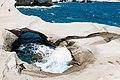 Waters of the Aegean Sea in a natural swimming pool among Sarakinko Cliffs on Milos, Greece.jpg