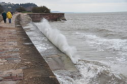 Waves breaking on the sea wall at Teignmouth (0146).jpg