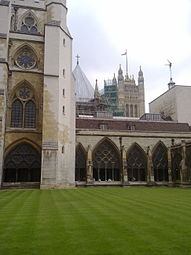 Westminster Abbey cloisters looking towards the Houses of Parliament.jpg