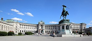 Hofburg - Hofburg Neue Burg section, seen from Heldenplatz. The statue of Archduke Charles is also pictured.