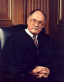 Rehnquist seated in robes