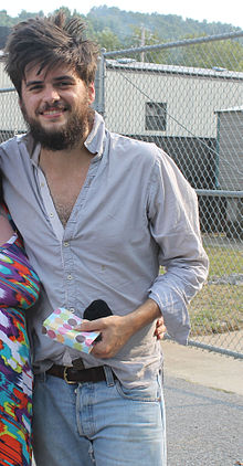 Winston Marshall of Mumford & Sons with a fan in Pelham, Alabama in September 9, 2013.jpg
