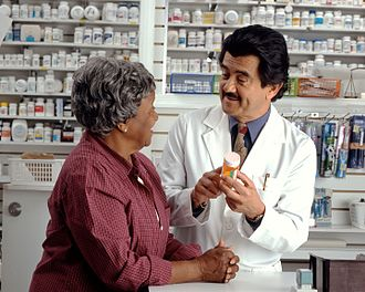 Pharmacist - Image: Woman consults with pharmacist