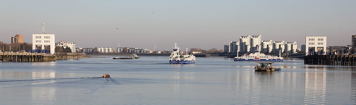 River Thames at Woolwich showing two vessels - the Ben Woollacott (centre) and the Dame Vera Lynn (right) - operating the cross-river ferry service.