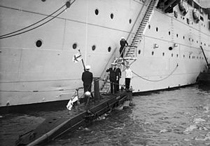 John Eccles (Royal Navy officer) - Admiral Sir John Eccles, Commander in Chief Home Fleet, boarding X craft MINNOW at Portland