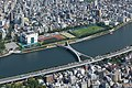 X-shaped pedestrian Sakura bridge over Sumida river, linking Taitō and Sumida wards, view from Tokyo Skytree, Japan.jpg