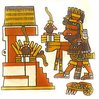 Mesoamerican ballgame - In this detail from the late 15th century Codex Borgia, the Aztec god Xiuhtecuhtli brings a rubber ball offering to a temple.  The balls each hold a quetzal feather, part of the offering.