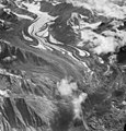 Yanert Glacier, valley glacier with rock glacier terminus in the foreground and curving moraines, August 25, 1963 (GLACIERS 5096).jpg