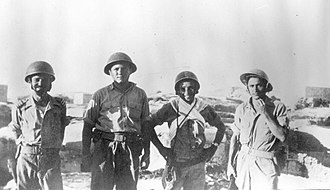 Yibna - Members of the Yiftach Brigade standing on the roof of a building in Yibna at the start of Operation Dani