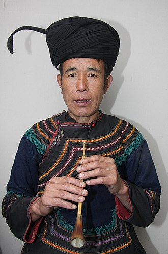 Yi people - Yi man in traditional dress