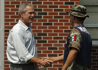 Naval Infantry Force - U.S. President George W. Bush conveys his gratitude to a Mexican marine, on their clean up efforts in Gulfport, Mississippi after Hurricane Katrina in 2005