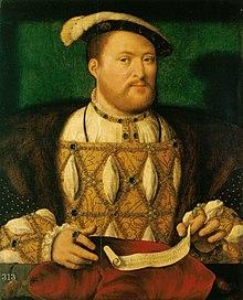 Portrait d'un homme joufflu avec une courte barbe rousse. Il porte un ample manteau ordé de joyaux avec des brodures dorées