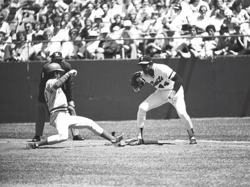 Willie McCovey attempts to tag Cincinnati Reds' shortstop Dave Concepcion out at first base in McCovey's final game at Candlestick Park, Copyright 1980 Sheldon Dunn 198009-012WillieMcCoveyLastCandlestick.png