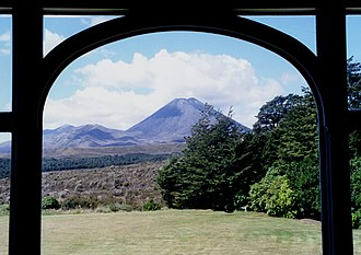 """Chateau Tongariro - Ngauruhoe from the blue sofa in the sitting area ("""" Mount Doom """")"""