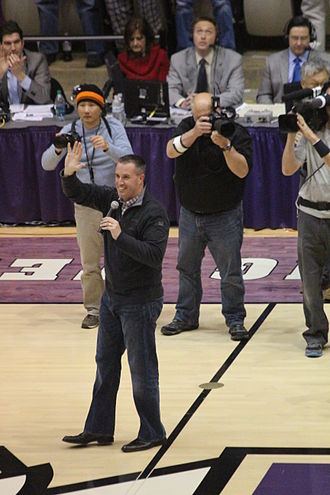 Pat Fitzgerald - Fitzgerald acknowledges the Welsh-Ryan Arena crowd two days after leading Northwestern to victory at the 2013 Gator Bowl (January 3, 2013)