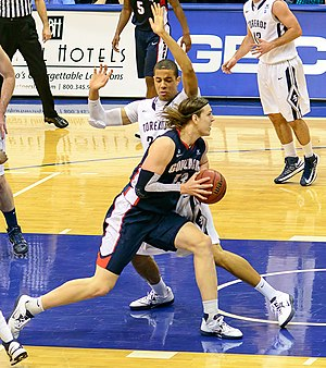 2012–13 Gonzaga Bulldogs men's basketball team - Gonzaga center Kelly Olynyk drives against Jito Kok in a conference game against San Diego on February 2, 2013