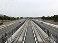 2018-10-26 11 06 35 View west along Virginia State Route 267 (Dulles Toll and Access Roads) and the Silver Line of the Washington Metro from the overpass for Virginia State Route 602 (Reston Parkway) in Reston, Fairfax County, Virginia.jpg